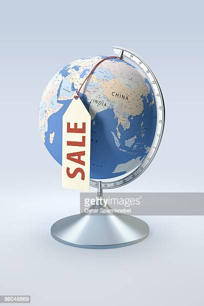 globe showing asia with a sale label