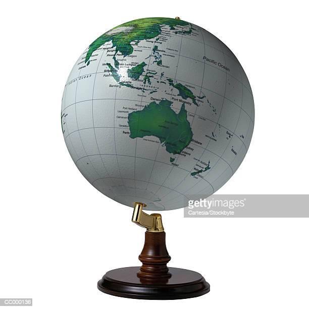 globe showing australia and southeast asia - mappamondo foto e immagini stock