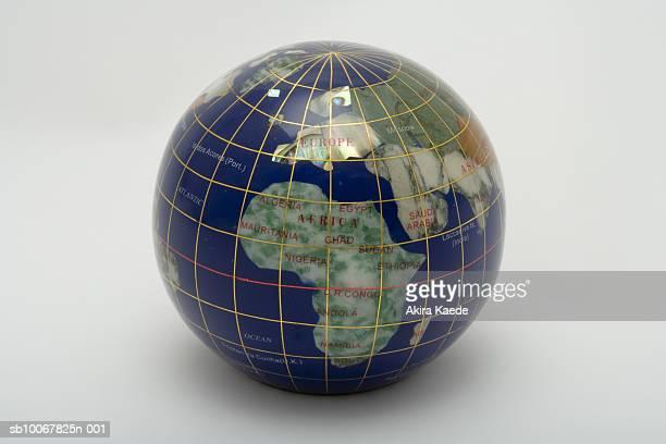 globe showing europe and africa, studio shot - längengrad stock-fotos und bilder