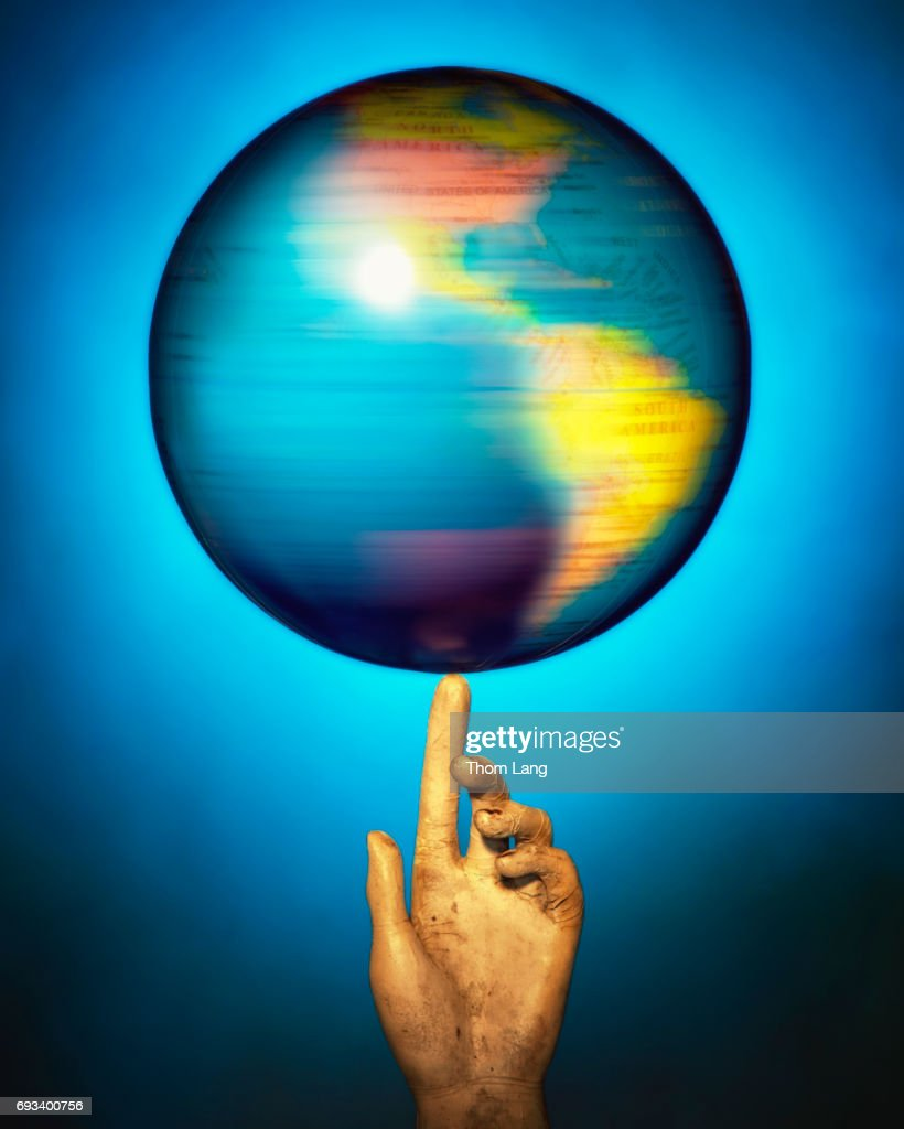 globe spinning on finger stock photo getty images