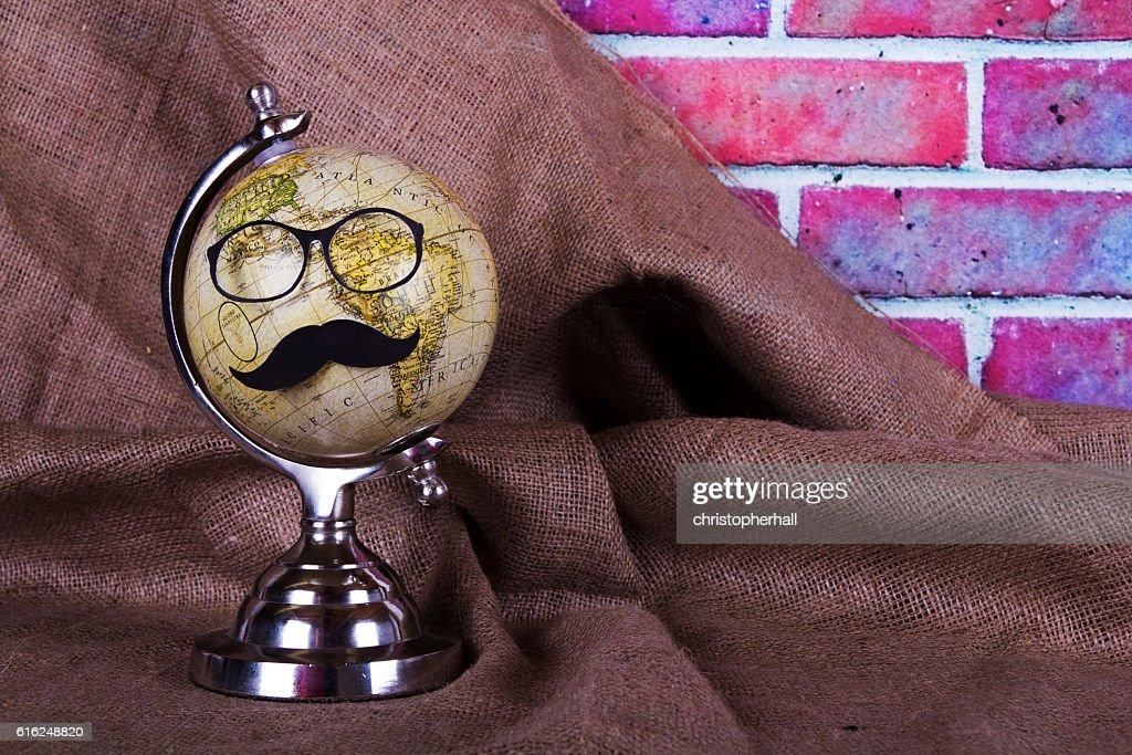 Globe with a black hipster mustache : Foto de stock