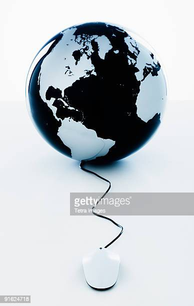 A globe with a computer mouse
