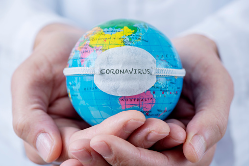 globe with a mask and text coronavirus 1203187628