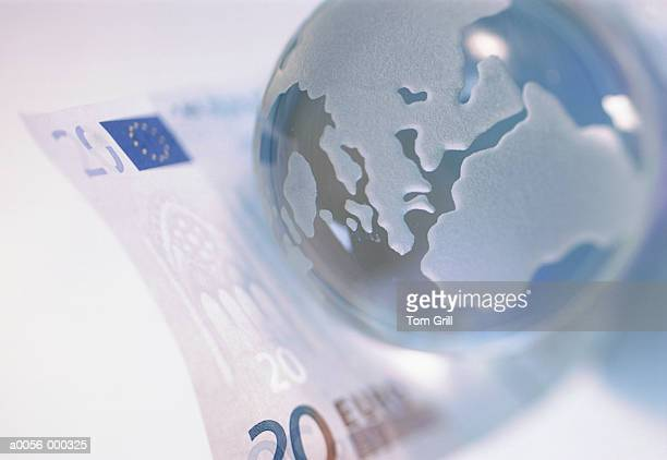 globe with euro note - twenty euro banknote stock photos and pictures
