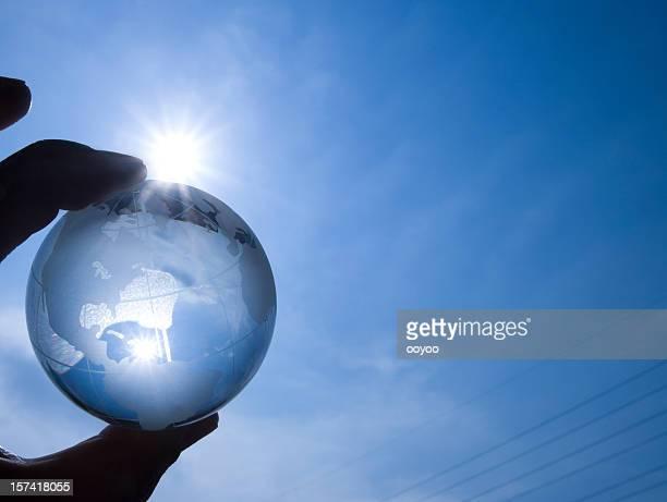 Globus mit Sonnenlicht