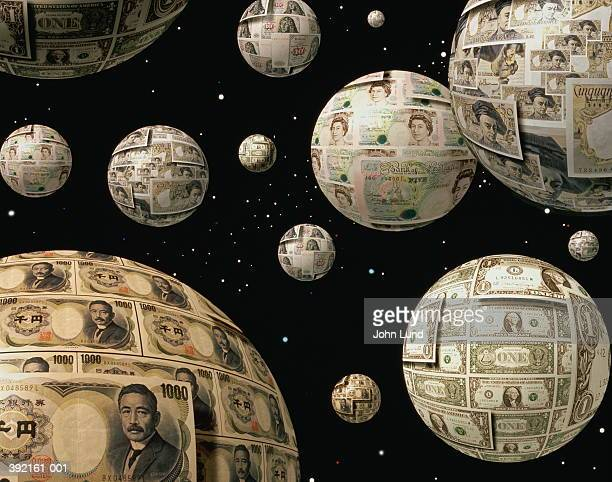 Globes covered with various currencies suspended in space