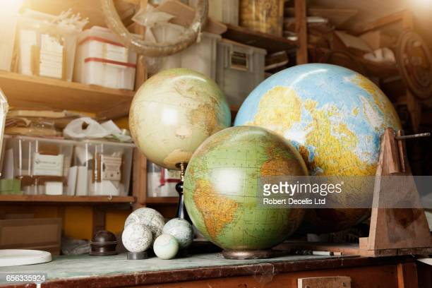Globes on work bench in work shop