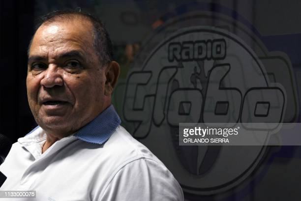 Globo radio and TV director Honduran journalist David Romero conducts a morning programme as he remains barricaded at the station's premises, which...