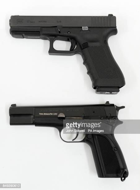 A Glock 17 9mm pistol and its predecessor a Browning 9mm at the Woolwich Barracks southeast London as personnel from all three services are to start...