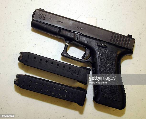 Glock 9mm pistol legal to own under present guns laws is displayed with 2 different capacity bullet clips at Shooters USA target range on September...