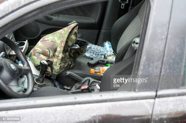 A Glock handgun sits on the seat of a black Alfa Romeo used by a man suspected of wounding several foreign nationals in a driveby shootingis blocked...