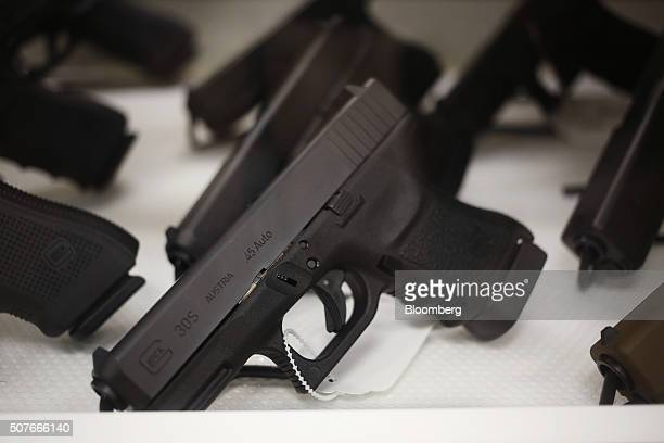 Glock Inc handguns are displayed for sale inside a gun store during a campaign event for Donald Trump president and chief executive of Trump...