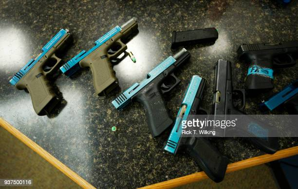 Glock pistols converted to fire Simunition are seen at a Tac*One Consulting 'Lone Wolf' civilian active shooter response course for concealed weapons...