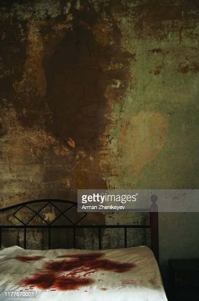 a gloomy room with bloodstained mattress on the bed. - mass murder stock pictures, royalty-free photos & images