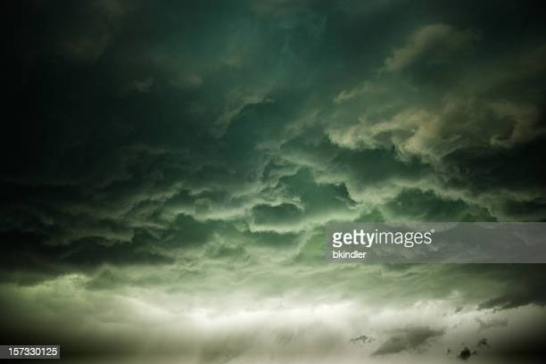gloomy storm clouds rolling in - storm cloud stock pictures, royalty-free photos & images