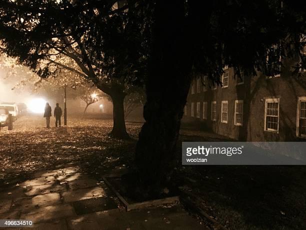 Gloomy street, people walking