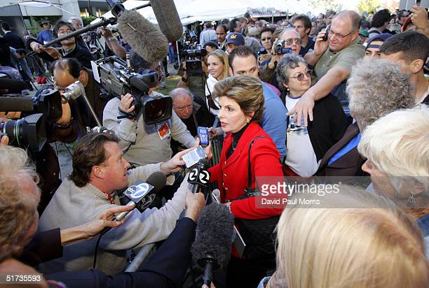 Gloria Allred attorney for Amber Frey speaks to the media as she leaves the courthouse after Scott Peterson was convicted of murder November 12 2004...