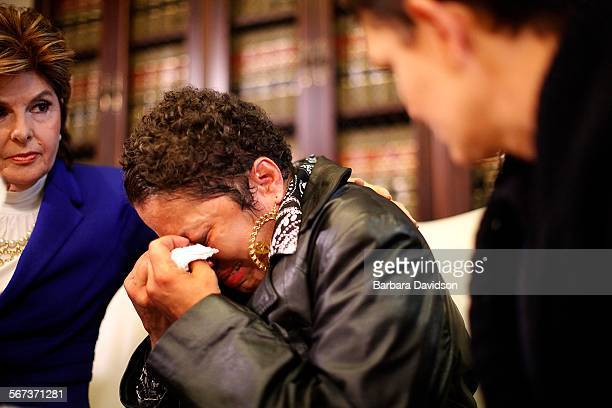 LOSANGELES CA November 27 2014 Gloria Allred consoles Cehlan center as Beth Ferrier looks on Dec 03 2014 Three victims Beth Ferrier Helen Hayes and...