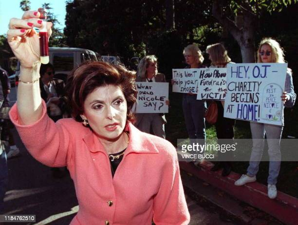 Gloria Allred, spokesperson for the family of murder victim Nicole Brown Simpson, holds a vile of blood in symbolic protest of a fundraising event...