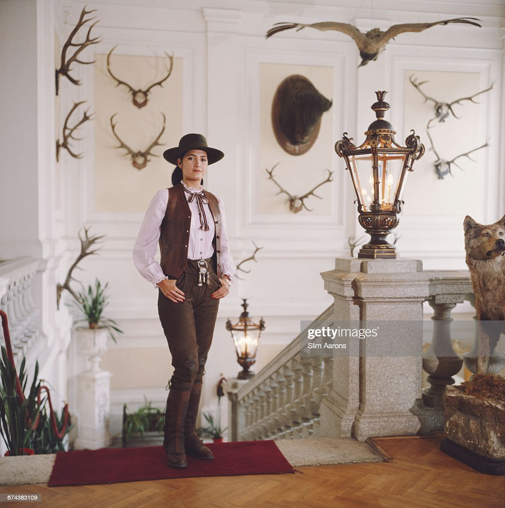 Gloria Andion poses in front of shooting and hunting trophies at the Zidlochovice castle in Moravia, Czech Republic, 1983.