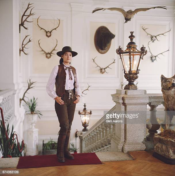 Gloria Andion poses in front of shooting and hunting trophies at the Zidlochovice castle in Moravia Czech Republic 1983