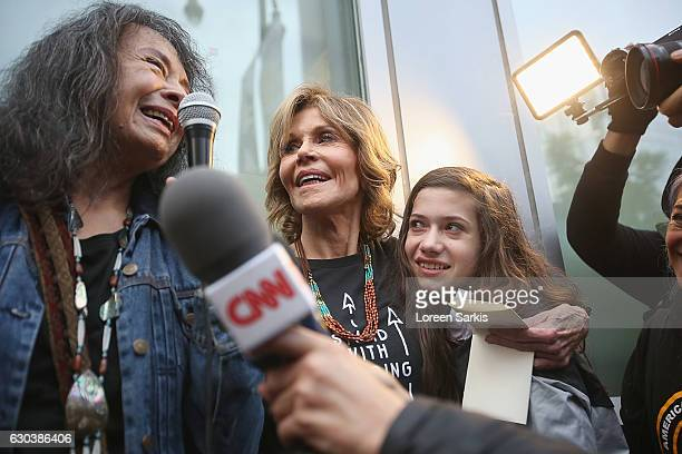 Gloria Arianas Jane Fonda and Viva Vadim attend #BankExit Rally on December 21 2016 in Los Angeles California