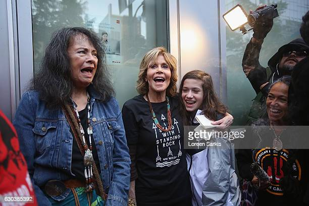 Gloria Arianas Tongve tribal elder Jane Fonda and Viva Vadim attend #BankExit Rally on December 21 2016 in Los Angeles California