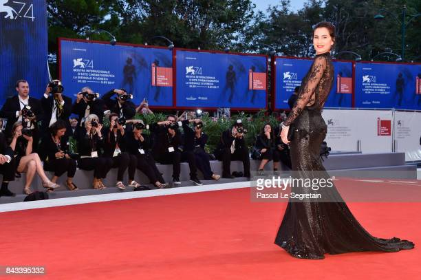 Gloria Bellicchi walks the red carpet ahead of the 'Ammore E Malavita' screening during the 74th Venice Film Festival at Sala Grande on September 6...