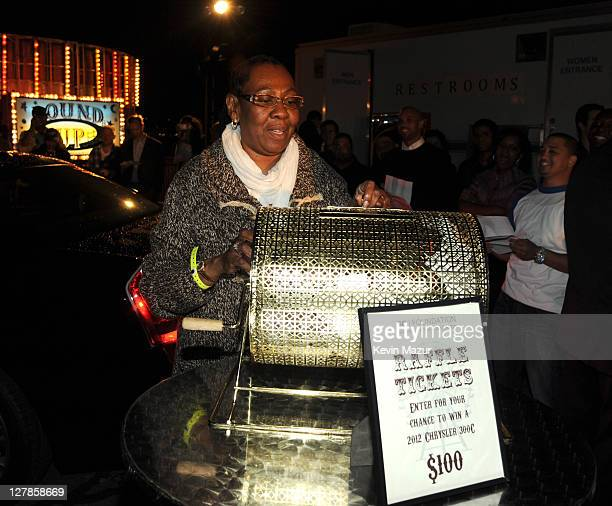 Gloria Carter announces the winner of the Chrystler 300 at an evening of Making The Ordinary Extraordinary hosted by The Shawn Carter Foundation at...