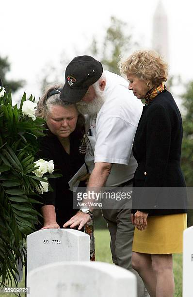 Gloria Clodfelter and her husband John of Richmond Virginia touch the tombstone of their son Kenneth after they laid a wreath as White House...