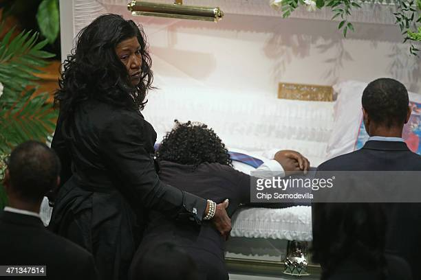 Gloria Darden Freddie Gray's mother leans into his casket during his funeral at the New Shiloh Baptist Church April 27 2015 in Baltimore Maryland...