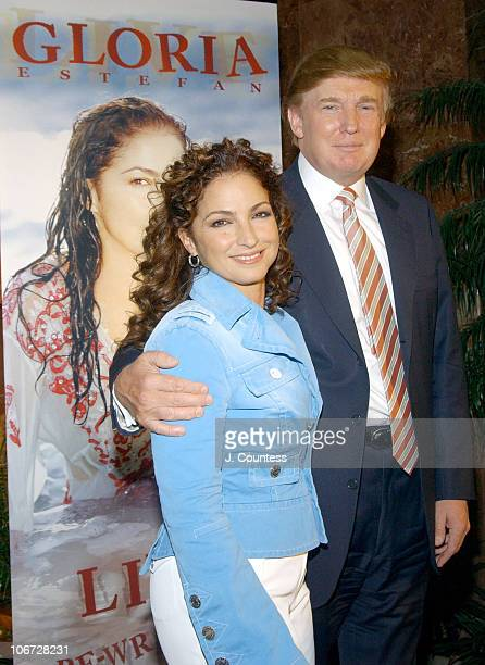 Gloria Estefan and Donald Trump during Gloria Estefan Announces her Live and ReWrapped Final Concert Tour Summer 2004 at Trump Tower in New York City...