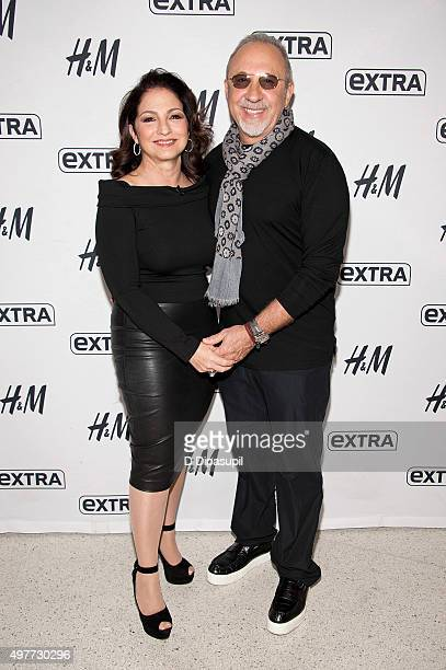 "Gloria Estefan and Emilio Estefan visit ""Extra"" at their New York Studios at H&M in Times Square on November 18, 2015 in New York City."