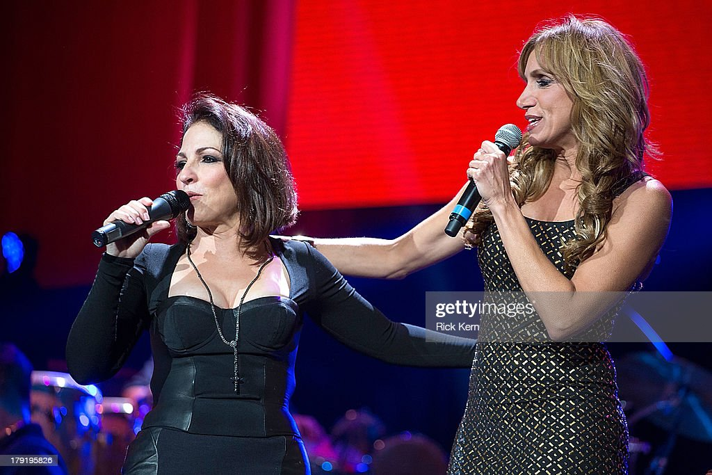 Gloria Estefan and host Lili Estefan speak on stage at the Festival People en Español Presented by Target at The Alamodome on August 31, 2013 in San Antonio, Texas.