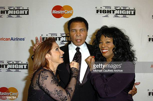 Gloria Estefan Muhammad Ali and Donna Summer during Celebrity Fight Night XI at Arizona Biltmore Resort in Phoenix Arizona United States