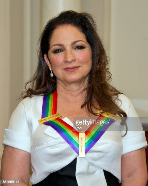 Gloria Estefan one of he five recipients of the 40th Annual Kennedy Center Honors with her award as he poses for a group photo following a dinner...