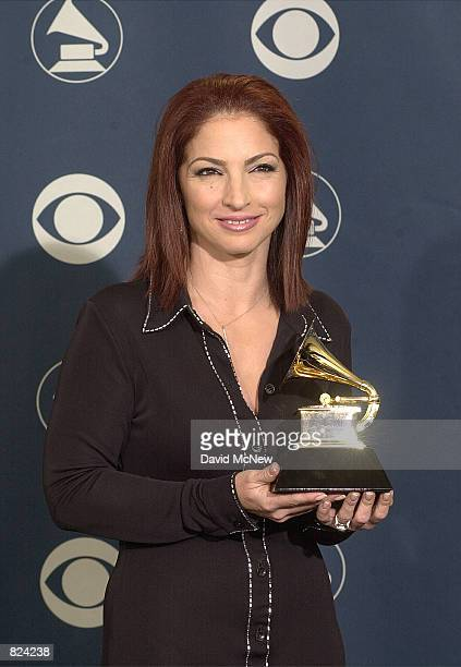 Gloria Estefan poses backstage with her award for Best Traditional Tropical Latin Album at the 43rd annual Grammy Awards February 21 2001 at Staples...