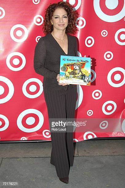 Gloria Estefan poses with her book Noelle's Treasure Tale during the Target Celebrates The Joy Of Reading In The Park event at Bryant Park on October...