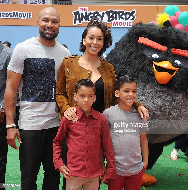 Gloria Govan Derek Fisher and children Carter Kelly Barnes and Isaiah Michael Barnes arrive at the premiere of Sony Pictures' 'The Angry Birds Movie'...