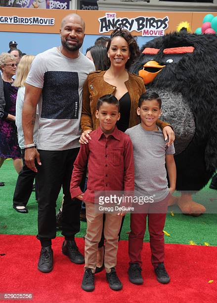 Gloria Govan Derek Fisher children Carter Kelly Barnes and Isaiah Michael Barnes arrive at the premiere of Sony Pictures' 'The Angry Birds Movie' at...