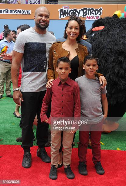 Gloria Govan Derek Fisher children Carter Kelly Barnes and Isaiah Michael Barnes arrive at the premiere of Sony Pictures' The Angry Birds Movie at...