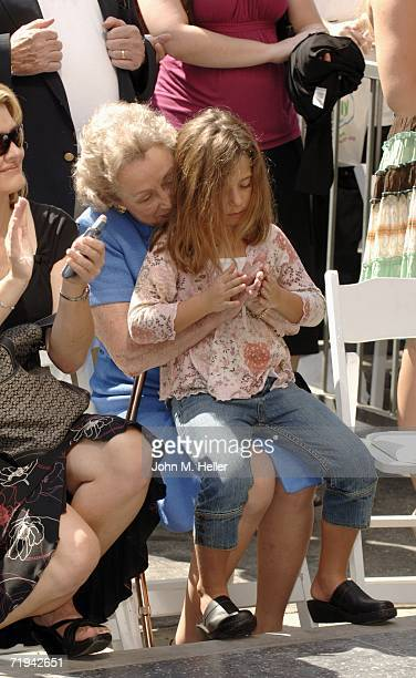 Gloria Grant holds her grandaughter while her daughter Amy Grant receives a star on The Hollywood Walk of Fame September 19 2006 in Hollywood...