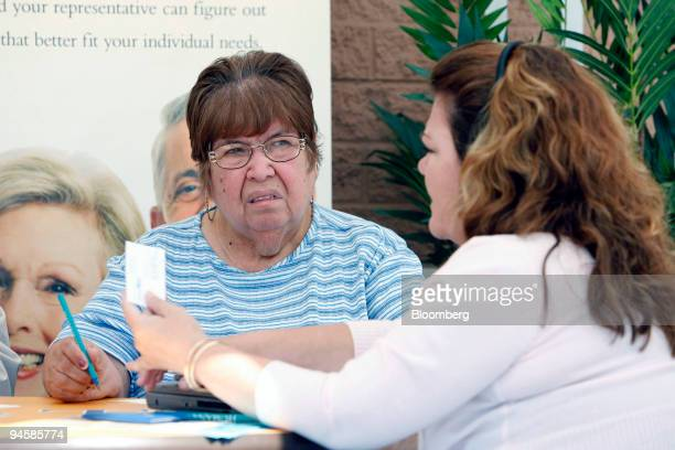 Gloria Guzman left 68 of Guadalupe Arizona talks with Connie Parra 47 of El Mirage Arizona to see if she needs to make any changes to her Medicare...