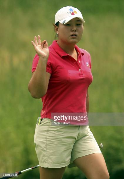 Gloria HeeJung Park of South Korea waves to the crowd on the 12th during the first round of the HSBC Women's World Match Play Championship on July 6...