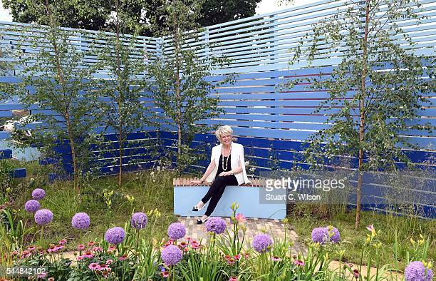 Gloria Hunniford poses in the Cancer Research 'Life Garden' during the launch of the RHS Hampton Court Flower Show at Hampton Court Palace on July 4...