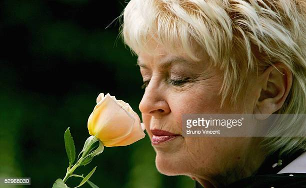 Gloria Hunniford smells the Caron Keating Rose at the Royal Horticultural Society's Chelsea Flower Show May 23 2005 in London The rose is named after...