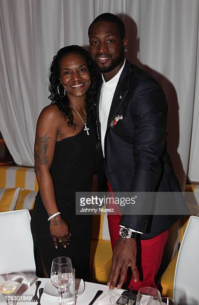 Gloria James and Dwyane Wade attend the Remy V New Years Eve dinner at The Shelborne Hotel on December 31 2011 in Miami Florida