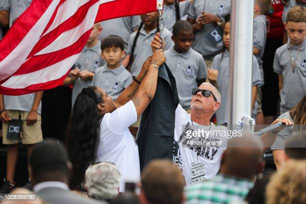 Gloria James LeBron's mother helps raise the new school flag at the grand opening of the I Promise school on July 30 2018 in Akron Ohio The new...