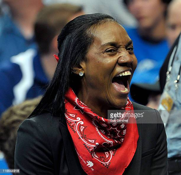 Gloria James mother of LeBron James laughs during a timeout in the first half of Game 4 of the NBA Finals between the Miami Heat and the Dallas...