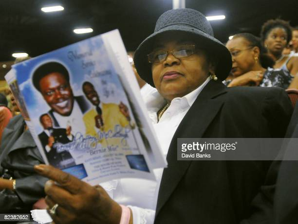 Gloria Lane reads the program at a memorial service for Bernie Mac at the The House of Hope Church on August 16, 2008 in Chicago, Illinois.